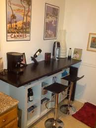 simple black color kitchen breakfast bar with storage features