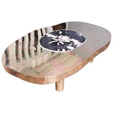 coffee table petrus black petrified wood and etched brass by