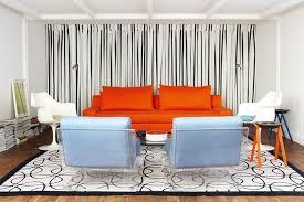 Orange Sofa Living Room Ideas Geometric Printed Rug And Orange Sofa For Chic Living Room Ideas