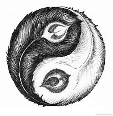 making tribal ying yang tattoo on upper back