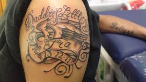 memorable banner and daddy little text tattoo on men u0027s bicep