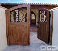 spanish style wooden gates dynamic garage door designer spanish style wooden gates dynamic garage door designer pedestrian gate architectural gates