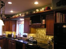 Decorating Above Cabinets In Kitchen Pictures Decorating Above Kitchen Cabinets Inspire Home Design