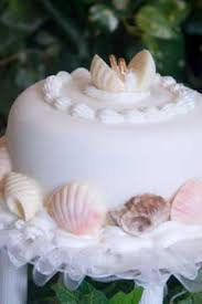 pictures of seashell wedding cakes for a beach wedding theme