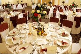 wedding reception table decorations table with white tablecloth combine by bouquet in glass