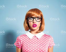 polka dot hair surprised hair woman wearing polka dot dress stock photo