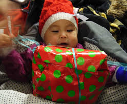 santa in the act gifts greenlandic children during
