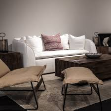 pacifica sofa in white linen with the drift chair and ottoman in
