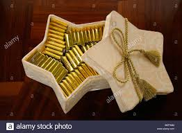 gold bars of swiss chocolate in a star shaped box on a wood table