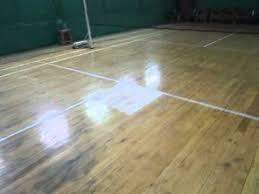 wooden floor badminton court with scuff marks cdtblr712