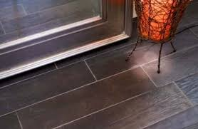 Laminate Flooring For Kitchen by Porcelain Wood Look Tiles Or Laminate Wood Floors