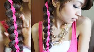 hispanic woman med hair styles braided sock bun hairstyle for long hair with strand ribbon best