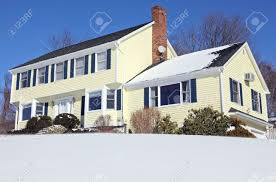traditional american colonial style house in winter stock photo