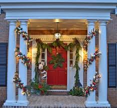 Christmas Decorations For A Front Porch Columns by Decorating The Porch For Christmas With Natural Garland Sled Ice