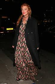 lindsay lohan dons floral maxi dress as she returns to london