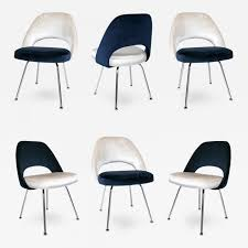 eero saarinen saarinen executive armless chairs in ivory navy