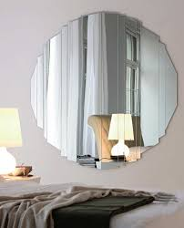 round mirror without frame white wall paint desklamp gray wall