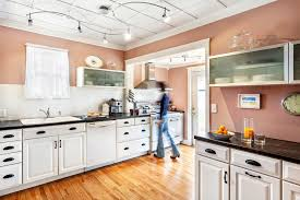 Cottage Kitchen Cupboards - good looking cappuccino cups in kitchen transitional with kitchen
