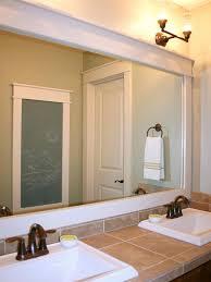 wooden frame for medium sized bathroom mirror hanging on creamy