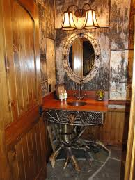 this rustic adirondack style powder room designed for one my