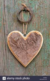 wooden heart on tree bark as symbol for love stock photo royalty