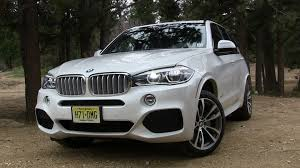 2011 bmw x5 xdrive50i 0 60 2014 bmw x5 xdrive50i defies the laws of physics review the