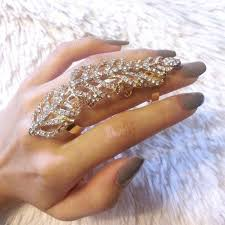 knuckle finger rings images Jewels feather ring the bling ring large ring gold ring nails jpg