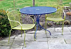 spectacular white spray painted metal patio furniture and tea in my garden