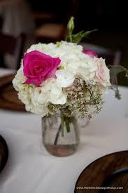 Mason Jar Floral Centerpieces Feminine And Chic Floral Centerpiece Of White And Pink In A Mason
