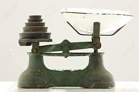 old kitchen scale with metal weights stock photo picture and