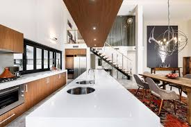 glossy white countertop design of the kitchen set and island