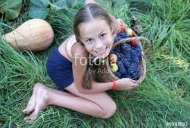 preteen girl modeling preteen girl with basket full of organic grapes and apples stock