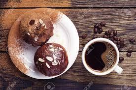 top view of a cup of coffee and cupcake with chocolate and nuts