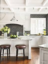 black backsplash in kitchen white kitchen with a black subway tile backsplash backsplashes