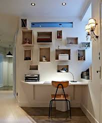 small hallway home office with lots of storage and unique wall