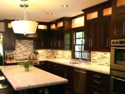 contrast brown kitchen cabinets with white granite countertops