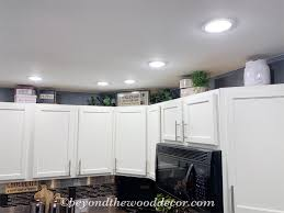 how to decorate space above kitchen cabinets decorating above kitchen cabinets beyond the wood diy