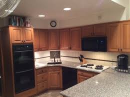 kitchens with black appliances and oak cabinets help honey oak kitchen black appliances