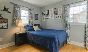 tiny rooms design frilled light blue window drapes black wooden