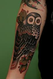 cute detailed owl tattoo on girls arm