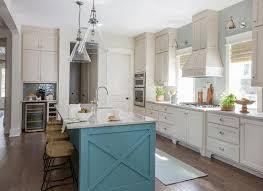 ivory kitchen hood with blue center island transitional kitchen