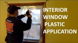interior window insulating plastic application keep your blinds