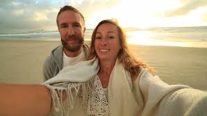 Take A Selfie Cheerful Young Couple On The Beach Take A Selfie Portrait At