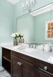 what color goes with brown bathroom cabinets brown bath vanity cabinets with blue walls transitional