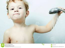 smiling little boy is bathed in the shower bath child stock images royalty free stock photo