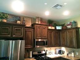 kitchen cabinets top decorating ideas top of kitchen cabinet decor upper kitchen cabinet decor
