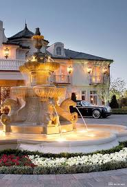 french chateau style driveway with fountain pictures photos and