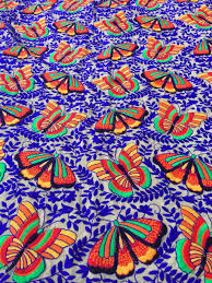 flutterby butterfly embroidered silk fabric from rajasthan india text