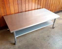 coffee table with caster wheels stainless steel coffee table with adjustable shelf on lockable