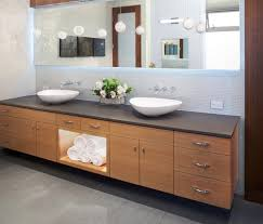 great bathroom with wide rectangular wall mirror and long wooden